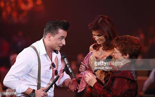 Andreas Gabalier Andrea Berg and her mother Helga Zellen gesture during the Andrea Berg 'Die 20 Jahre Show' at Baden Arena on December 7 2012 in...