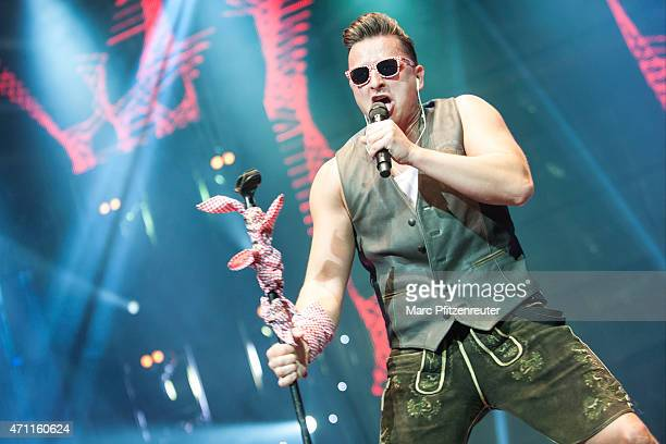 Andreas Gabalier performs on stage during the 'Schlagernacht des Jahres' at the Lanxess Arena on April 25 2015 in Cologne Germany