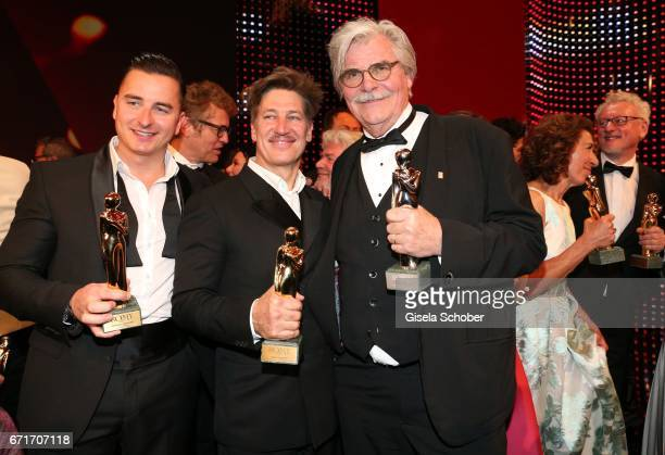 Andreas Gabalier Tobias Moretti and Peter Simonischek with award during the ROMY award at Hofburg Vienna on April 22 2017 in Vienna Austria