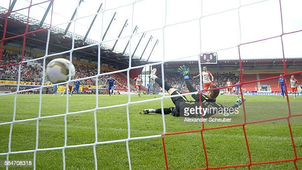 Andreas Geipl of Jahn Regensburg scores the first goal for his team with a penalty against Marcel Schuhen of Hansa Rostock during the Third League...