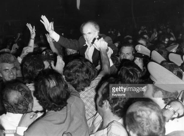 Andreas George Papandreou the Greek politician returns to Greece and is greeted by a welcoming crowd in Athens as he is carried shoulder high