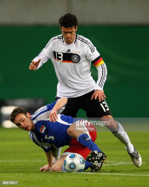 Andreas Gerster of Liechtenstein slides in for the ball as Michael Ballack of Germany attacks during the FIFA 2010 World Cup Group 4 Qualifier match...