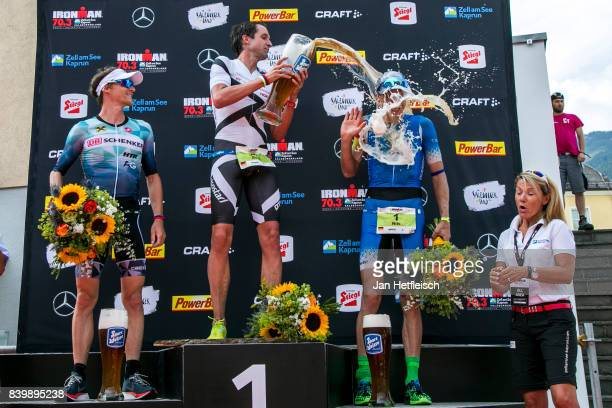Andreas Giglmayr from Austria Boris Stein of Germany and Nils Frommhold of Germany pose for a picture during the flower ceremony of the IRONMAN 703...