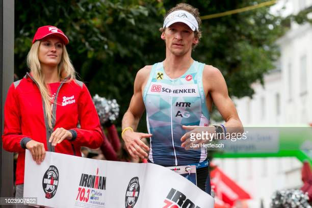 Andreas Giglmayr of Austria reacts after winning the second place of the IRONMAN 703 Zell Am See on August 25 2018 in Zell am See Austria