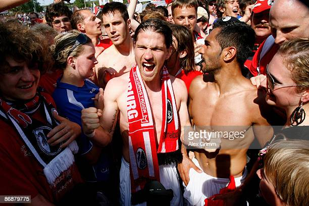 Andreas Glockner and Yacine Abdessadki of Freiburg celebrate with supporters after the Second Bundesliga match between TuS Koblenz and SC Freiburg at...