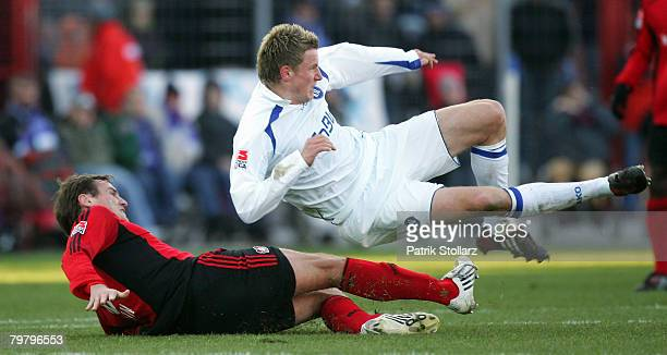Andreas Goerlitz of Karlsruhe competes Dmitry Bulykin of Leverkusen during the Bundesliga match between Karlsruher SC andBayer Leverkusen at the...