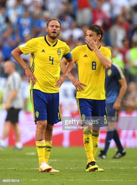 Andreas Granqvist and Albin Ekdal of Sweden show their dejection following the 2018 FIFA World Cup Russia Quarter Final match between Sweden and...