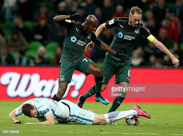 Andreas Granqvist and Charles Kabore of FC Krasnodar is challenged by Artyom Dzyuba of FC Zenit St Petersburg during the Russian Premier League match...