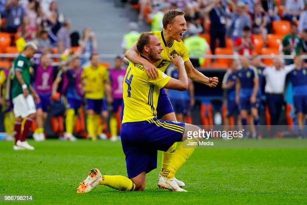 Andreas Granqvist and Ludwig Augustinsson of Sweden celebrate after winning the 2018 FIFA World Cup Russia group F match between Mexico and Sweden at...