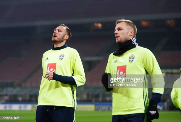 Andreas Granqvist and Sebastian Larsson of Sweden during a training session ahead of the FIFA 2018 World Cup Qualifier PlayOff Second Leg between...