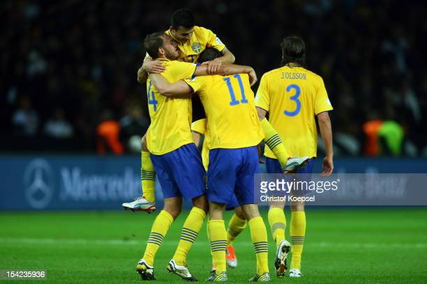 Andreas Granqvist Behrang Safari Johan Elmander and Jonas Olsson of Sweden celebrate the 44 draw after the FIFA 2014 World Cup qualifier group C...