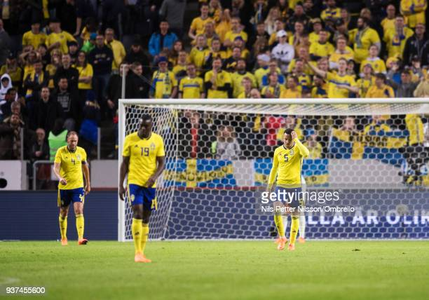 Andreas Granqvist Ken Sema and Martin Olsson of Sweden dejected after Chile has scored 12 during the International Friendly match between Sweden and...