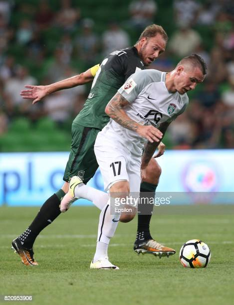 Andreas Granqvist of FC Krasnodar is challenged by Anton Zabolotny of FC Tosno Saint Petersburg during the Russian Premier League match between FC...