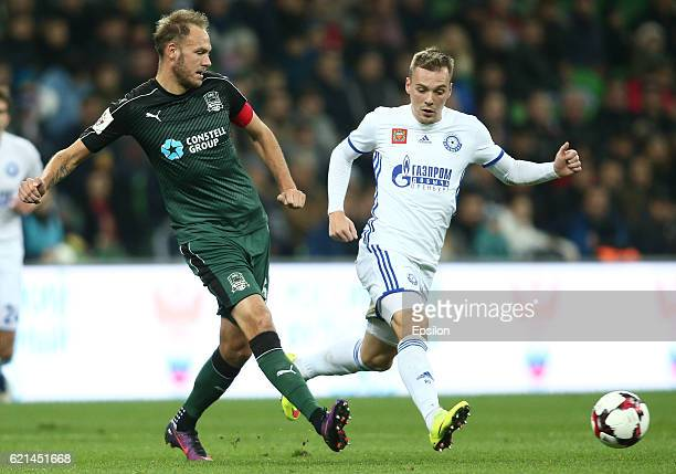 Andreas Granqvist of FC Krasnodar is challenged by Artyom Delkin of FC Orenburg during the Russian Premier League match between FC Krasnodar v FC...