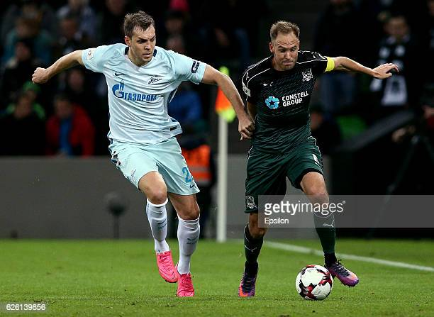 Andreas Granqvist of FC Krasnodar is challenged by Artyom Dzyuba of FC Zenit St Petersburg during the Russian Premier League match between FC...