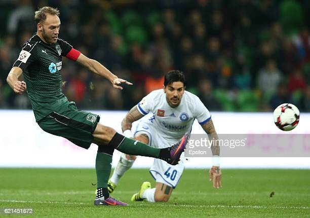 Andreas Granqvist of FC Krasnodar is challenged by Blagoy Georgiev of FC Orenburg during the Russian Premier League match between FC Krasnodar v FC...