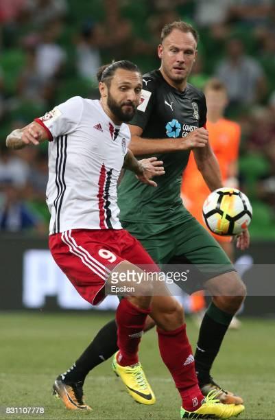 Andreas Granqvist of FC Krasnodar is challenged by Darko Bodul of FC Amkar Perm during the Russian Premier League match between FC Krasnodar v FC...