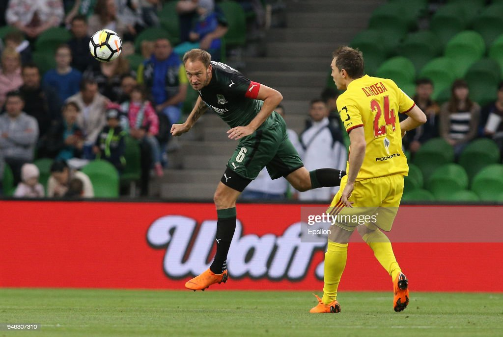 Andreas Granqvist (L) of FC Krasnodar vies for the ball with Artem Dzyuba of FC Arsenal Tula during the Russian Premier League match between FC Krasnodar v FC Arsenal Tula at Krasnodar Stadium on April 14, 2018 in Krasnodar, Russia.