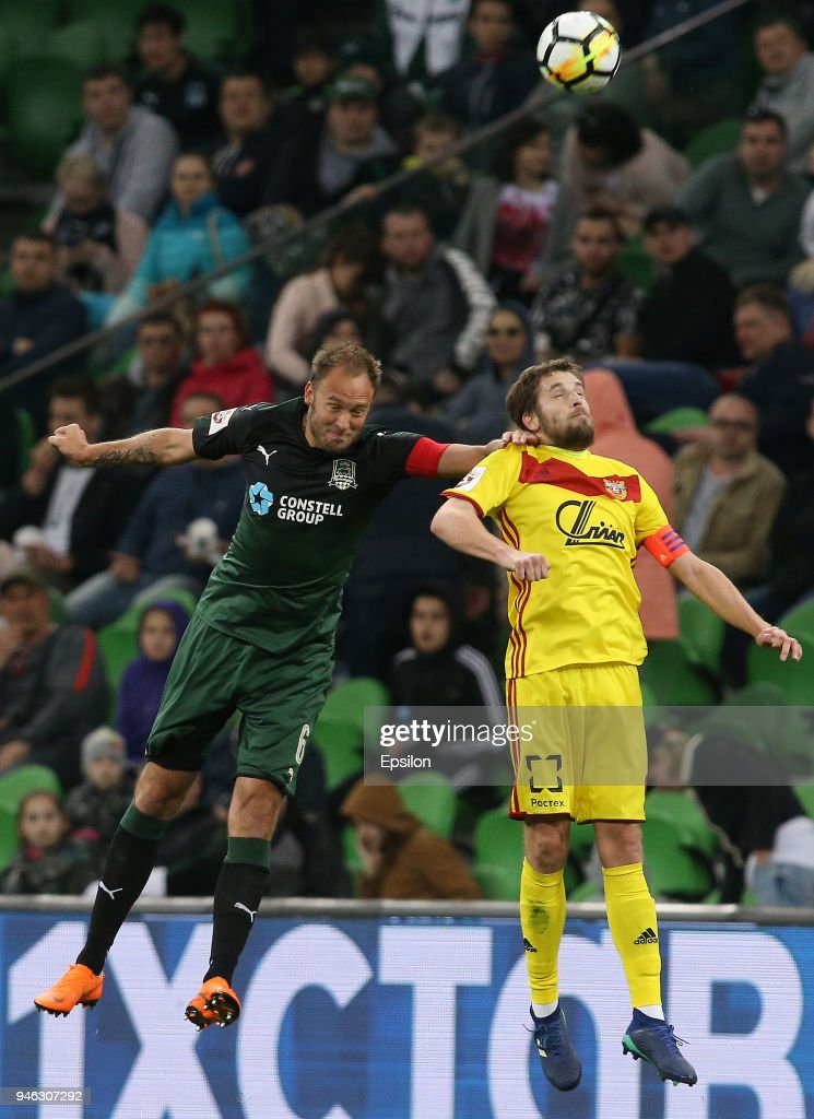 Andreas Granqvist (L) of FC Krasnodar vies for the ball with Kirill Kombarov of FC Arsenal Tula during the Russian Premier League match between FC Krasnodar v FC Arsenal Tula at Krasnodar Stadium on April 14, 2018 in Krasnodar, Russia.