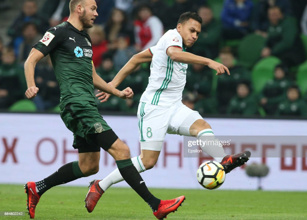 Andreas Granqvist (L) of FC Krasnodar vies for the ball with Leo Jaba of FC Akhmat Grozny during the Russian Premier League match between FC Krasnodar and FC Akhmat Grozny at Krasnodar Stadium on December 03, 2017 in Krasnodar, Russia.