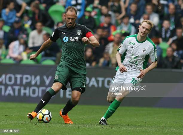 Andreas Granqvist of FC Krasnodar vies for the ball with Pavel Mogilevets of FC Rubin Kazan during the Russian Premier League match between FC...