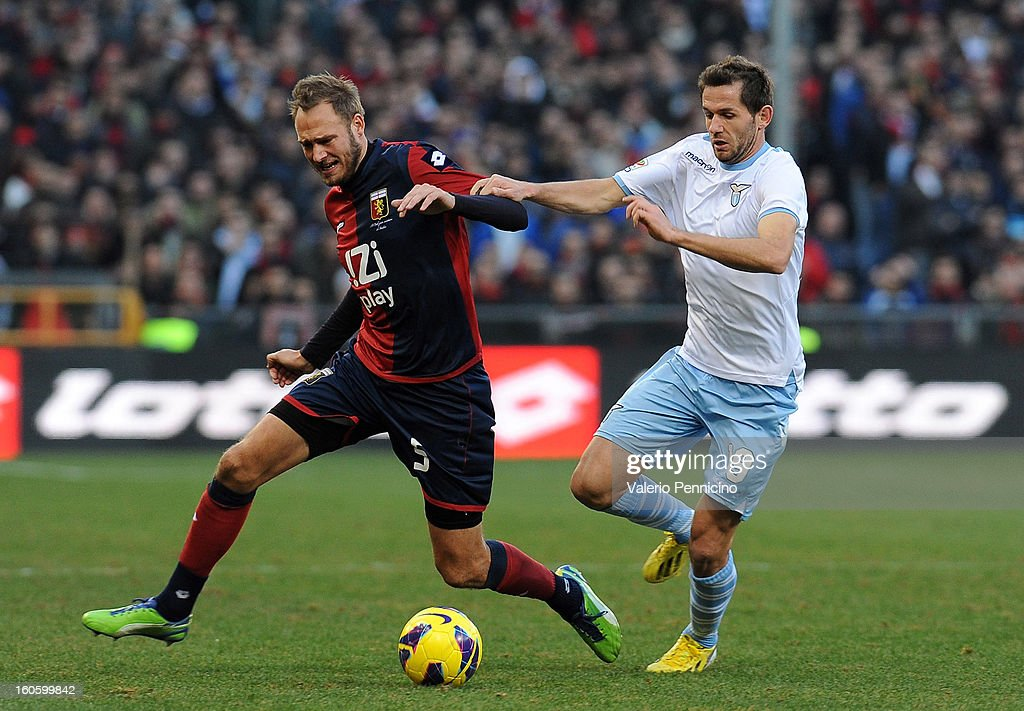 Andreas Granqvist (L) of Genoa CFC is challenged by Senad Lulic of S.S. Lazio during the Serie A match between Genoa CFC and SS Lazio at Stadio Luigi Ferraris on February 3, 2013 in Genoa, Italy.