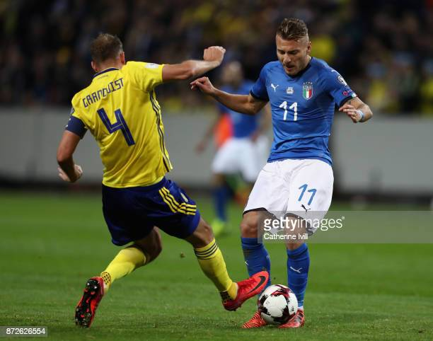 Andreas Granqvist of Sweden and Ciro Immobile of Italy battle for possession during the FIFA 2018 World Cup Qualifier PlayOff First Leg between...
