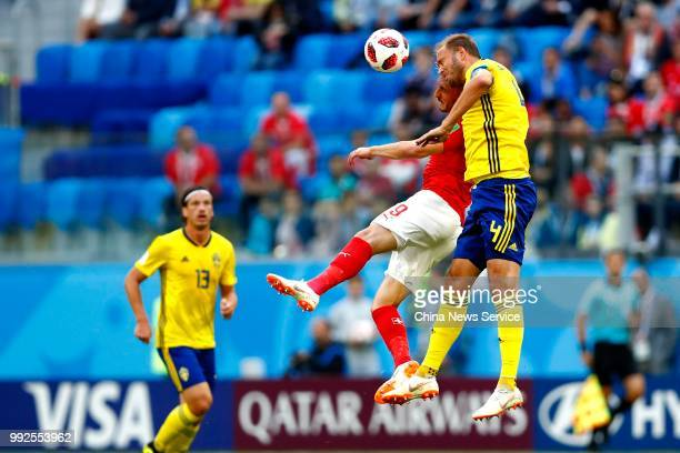 Andreas Granqvist of Sweden and Haris Seferovic of Switzerland head the ball during the 2018 FIFA World Cup Russia Round of 16 match between Sweden...