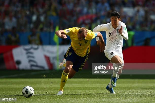 Andreas Granqvist of Sweden and Son HeungMin of Korea Republic challenge for the ball during the 2018 FIFA World Cup Russia group F match between...