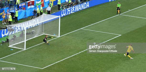 Andreas Granqvist of Sweden beats South Korea goalkeeper Cho HyunWoo and scores their 1st goal from the penalty spot during the 2018 FIFA World Cup...