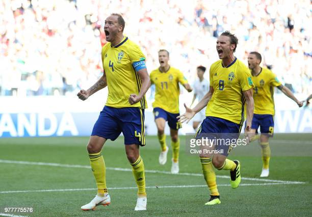 Andreas Granqvist of Sweden celebrates after scoring his team's first goal with team mate Albin Ekdal during the 2018 FIFA World Cup Russia group F...