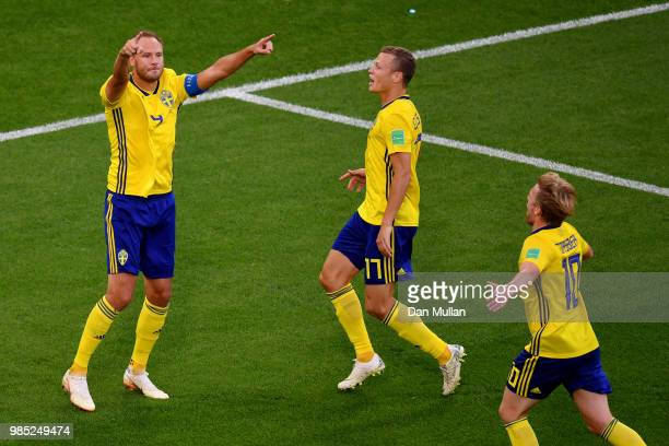 Andreas Granqvist of Sweden celebrates with teammates Viktor Claesson and Emil Forsberg after scoring his team's second goal during the 2018 FIFA...
