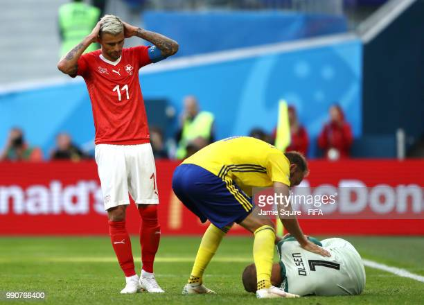 Andreas Granqvist of Sweden checks on Robin Olsen of Sweden who goes down during the 2018 FIFA World Cup Russia Round of 16 match between Sweden and...