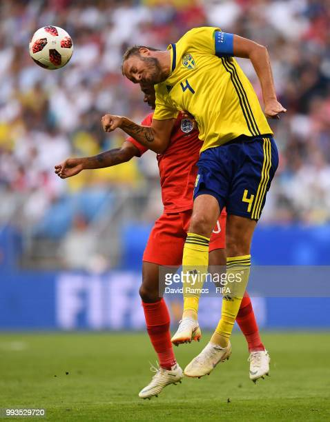 Andreas Granqvist of Sweden competes for the ball with Raheem Sterling of England during the 2018 FIFA World Cup Russia Quarter Final match between...
