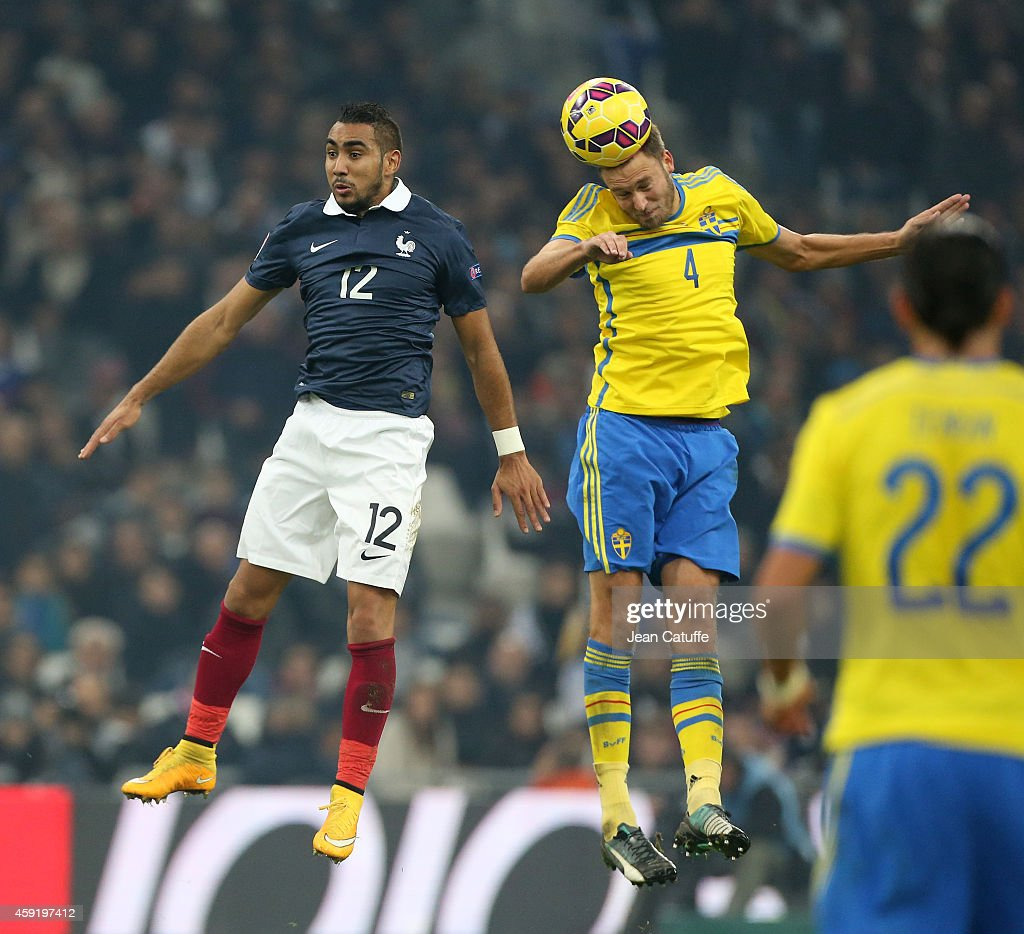Andreas Granqvist of Sweden (R) heads the ball over Dimitri Payet of France during the international friendly match between France and Sweden at the Stade Velodrome on November 18, 2014 in Marseille, France.