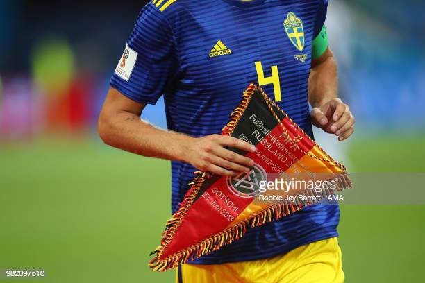 Andreas Granqvist of Sweden holds the Germany match pennant prior to the 2018 FIFA World Cup Russia group F match between Germany and Sweden at Fisht...