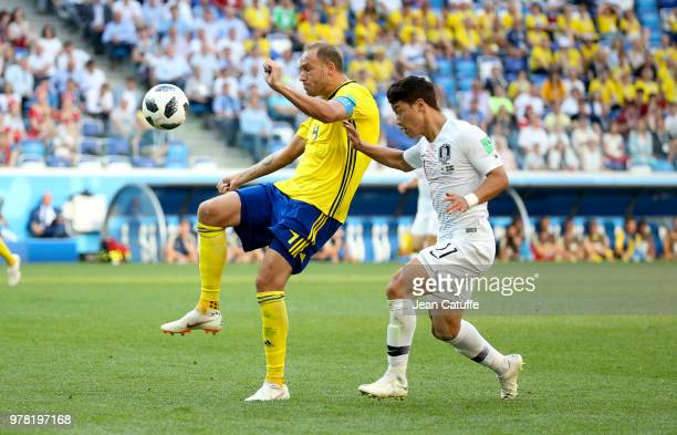 Andreas Granqvist of Sweden Hwang Heechan of South Korea during the 2018 FIFA World Cup Russia group F match between Sweden and Korea Republic at...