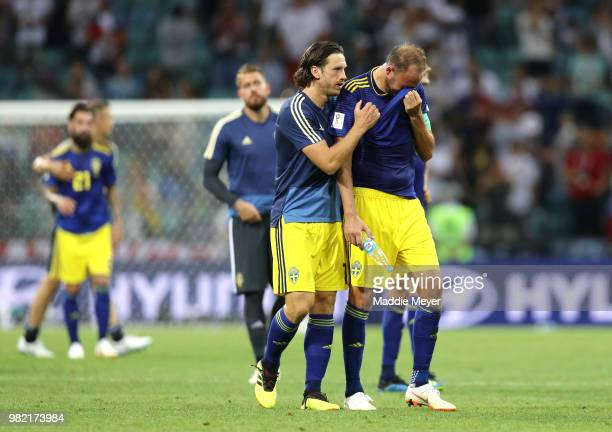 Andreas Granqvist of Sweden is consoled by teammate Gustav Svensson following the 2018 FIFA World Cup Russia group F match between Germany and Sweden...
