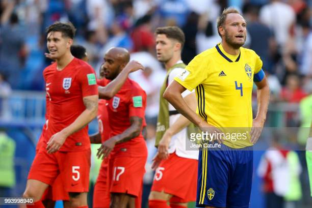 Andreas Granqvist of Sweden looks on while english players celebrate the victory following the 2018 FIFA World Cup Russia Quarter Final match between...