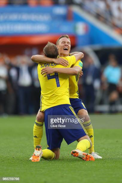 Andreas Granqvist of Sweden of Sweden celebrates victory with teammate Viktor Claesson during the 2018 FIFA World Cup Russia group F match between...