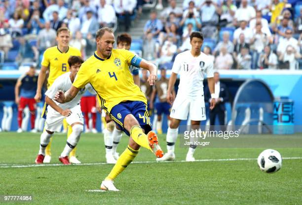 Andreas Granqvist of Sweden scores his team's first goal from the penalty spot during the 2018 FIFA World Cup Russia group F match between Sweden and...