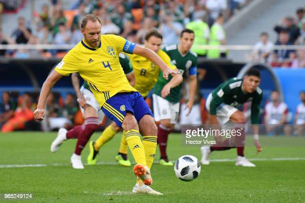 Andreas Granqvist of Sweden scores his team's second goal from the penalty spot during the 2018 FIFA World Cup Russia group F match between Mexico...