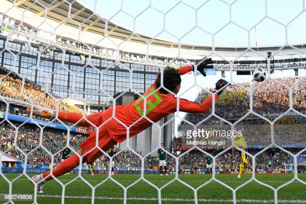 Andreas Granqvist of Sweden scores past Guillermo Ochoa of Mexico his team's second goal from the penalty spot during the 2018 FIFA World Cup Russia...