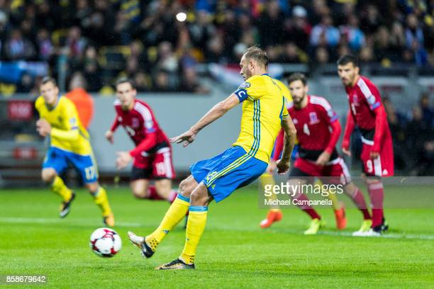 Andreas Granqvist of Sweden scores the opening 10 goal on penalty during the FIFA 2018 World Cup Qualifier between Sweden and Luxembourg at Friends...