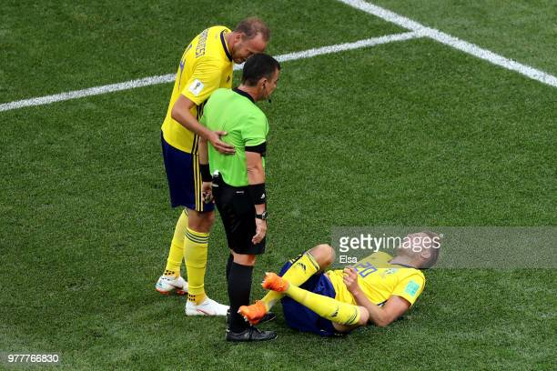 Andreas Granqvist of Sweden speaks with Referee Joel Aguilar as Ola Toivonen of Sweden goes down during the 2018 FIFA World Cup Russia group F match...