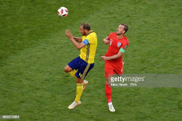 Andreas Granqvist of Sweden wins a header from Harry Kane of England during the 2018 FIFA World Cup Russia Quarter Final match between Sweden and...