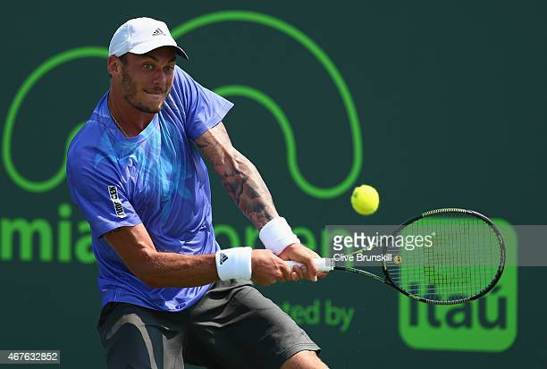 Andreas HaiderMaurer of Austria plays a backhand against Borna Coric of Croatia in their first round match during the Miami Open at Crandon Park...