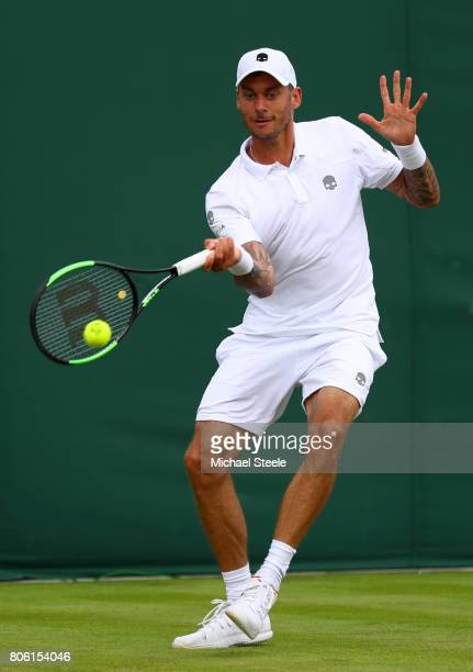 Andreas HaiderMaurer of Austria plays a forehand during the Gentlemen's Singles first round match against Roberto Bautista Agut of Spain on day one...