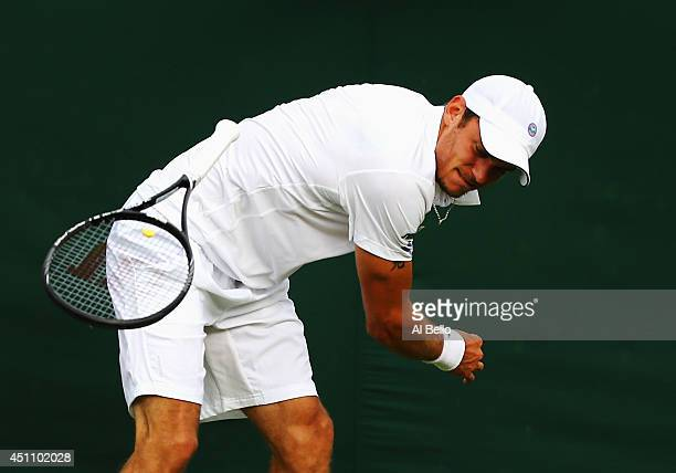 Andreas Haider-Maurer of Austria throws his raquet to the ground in frustration during his Gentlemen's Singles first round match against Kyle Edmund...