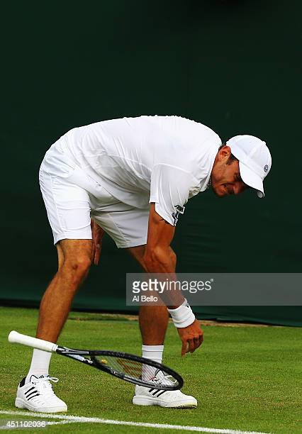 Andreas HaiderMaurer of Austria throws his raquet to the ground in frustration during his Gentlemen's Singles first round match against Kyle Edmund...